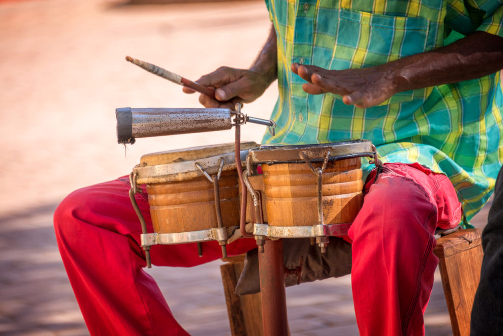 Street musician playing drums for CACAO Caribbean festival